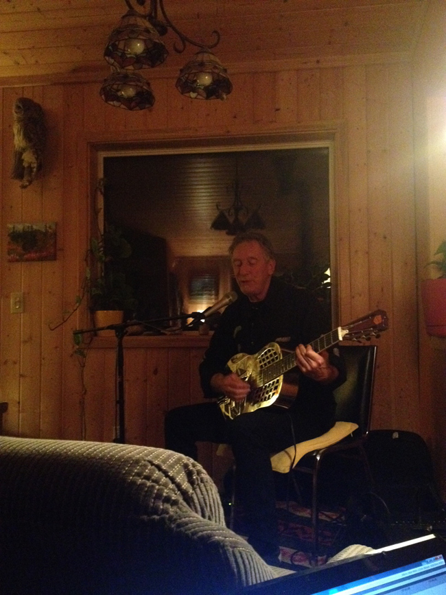 Terry Gillespie performing at a house concert in Haines Junction, Yukon in October 2015.
